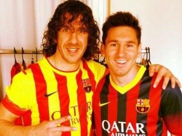Carles Puyol junto a Leo Messi
