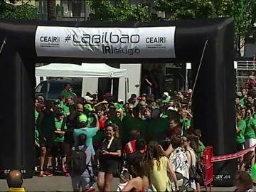 Bilbao se tiñe de verde en la carrera solidaria de apoyo a las personas refugiadas