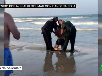 BORRADOR La Guardia Civil detiene a un hombre por no salir del mar con bandera roja