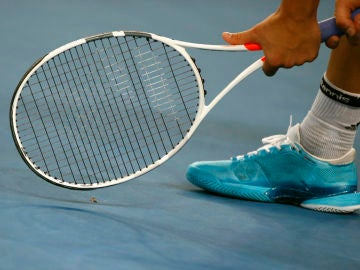 Momento de un partido de tenis