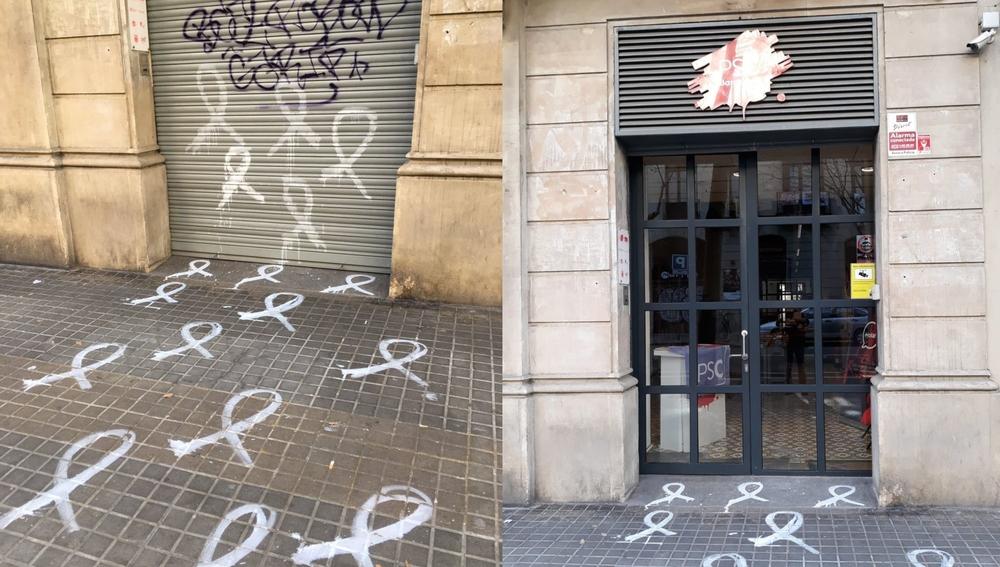 La sede del PSC e Barcelona amanece con pintadas de lazos blancos