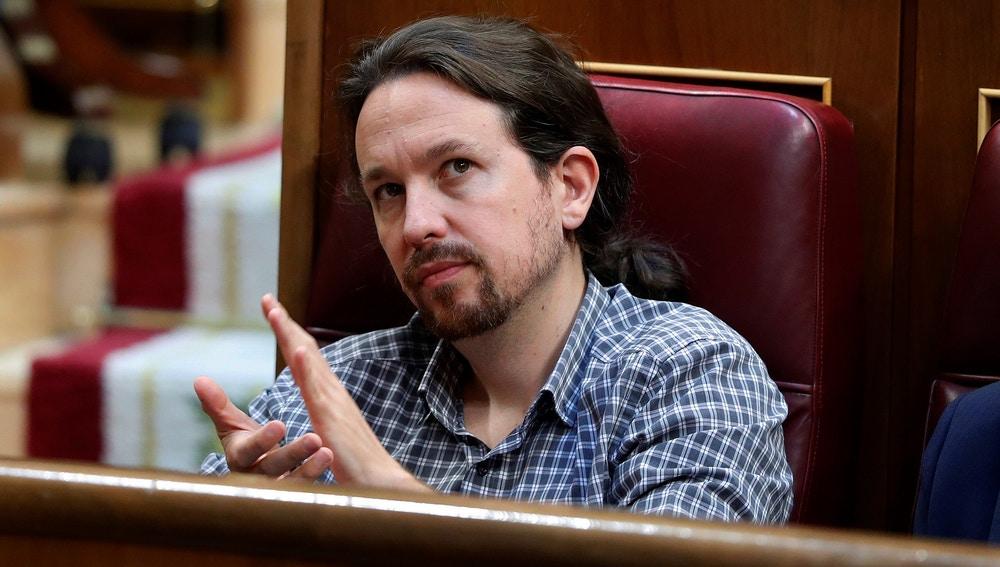 El secretario general de Podemos Pablo Iglesias, en el hemiciclo del Congreso en la primera jornada del debate de investidura