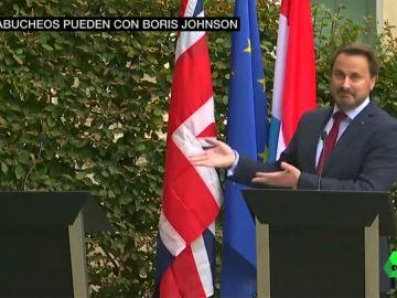 Boris Johnson planta al primer ministro de Luxemburgo para escapar de los abucheos