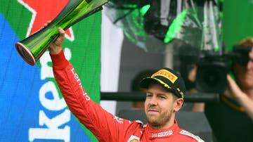 Vettel con el trofeo del GP de México