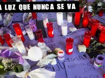 Imagen de archivo de flores y velas contra la violencia machista
