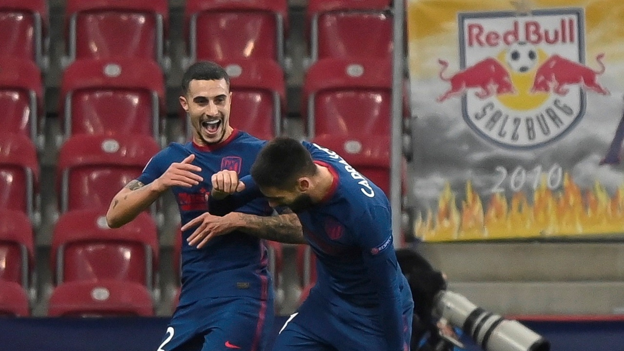 Hermoso y Carrasco celebran un gol del Atleti