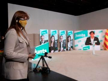 El acto de inicio de campaña de JuntsxCat, con Puigdemont vía Zoom y Laura Borràs en segundo plano.