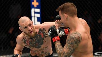 Conor McGregor y Dustin Poirier en el combate UFC 257