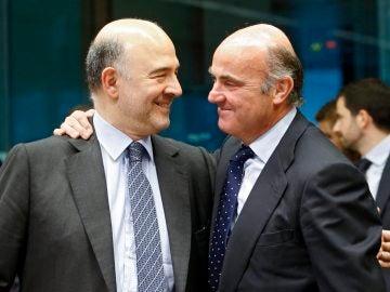 Pierre Moscovici y Luis de Guindos