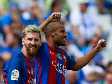 Rafinha junto a Leo Messi