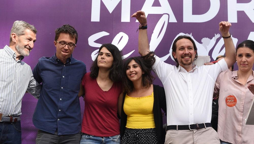 Miembros de Podemos, en el acto 'Madrid se levanta'