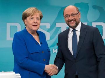Merkel y Schulz, antes de empezar el debate