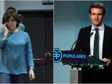 A la izquierda de la imagen, Soraya Sáenz de Santamaría; a la derecha, Pablo Casado