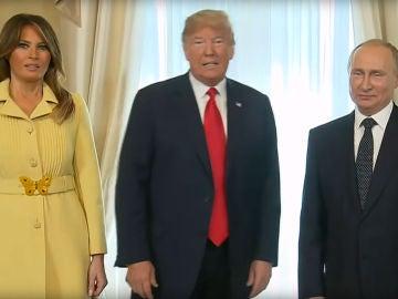 Melania y Donald Trump junto a Putin