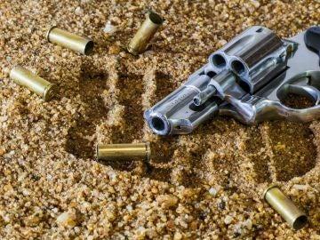 Revólver con balas
