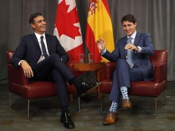 Pedro Sánchez junto a Justin Trudeau