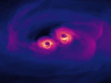 La increíble simulación de la unión de dos agujeros negros supermasivos en el universo