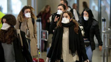 Gente protegida con mascarillas por el coronavirus