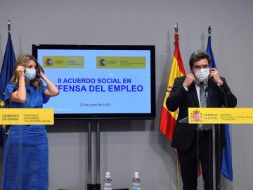 Los ministros de Trabajo y Seguridad Social, Yolanda Díaz y José Luis Escrivá