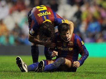 Carles Puyol y Gerard Piqué