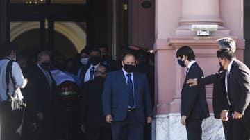 La salida del féretro de Maradona