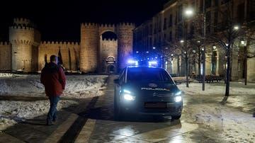 Un coche de la Policía Nacional en la plaza de Santa Teresa de Ávila