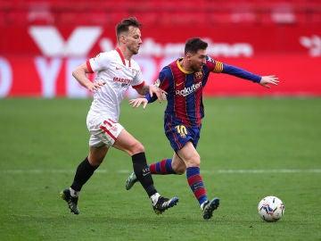Ivan Rakitic y Leo Messi